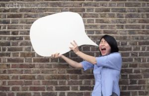 woman holding speech bubble