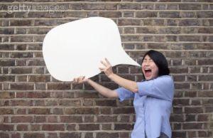 woman holding speech bubble